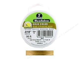 seed beads: Beadalon Bead Wire 7 Strand .018 in. Gold 30 ft.