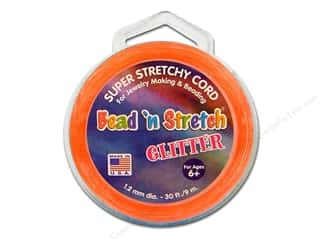 beading & jewelry making supplies: Toner Bead 'N Stretch Cord 1.2 mm x 30 ft. Glitter Orange