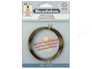 beading & jewelry making supplies: Beadalon German Style Wire 20ga Round Antique Brass 19.7 ft.