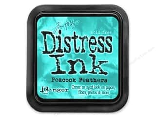 stamps: Tim Holtz Distress Ink Pad by Ranger Peacock Feathers