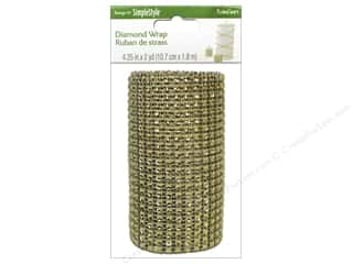 christmas ribbon: FloraCraft Diamond Wrap Ribbon 4 1/4 in. x 2 yd. Gold