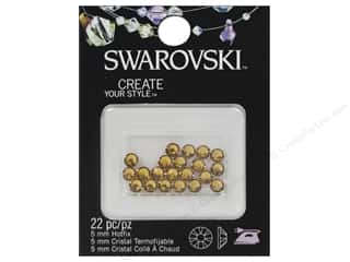 beading & jewelry making supplies: Cousin Swarovski Hotfix Rhinestones 5 mm 22 pc. Light Topaz