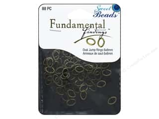 beading & jewelry making supplies: Sweet Beads Fundamental Finding Oval Jump Rings 8 x 6 mm Antique Gold 88 pc.