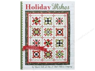 Holiday Wishes: 12 Quilts for a Homemade Holiday Book by Sherri Falls