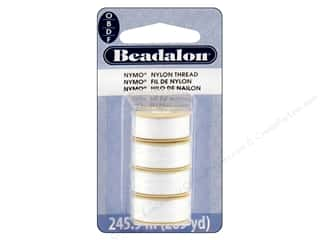 seed beads: Beadalon Nymo Thread Assorted Sizes 4 pc. White