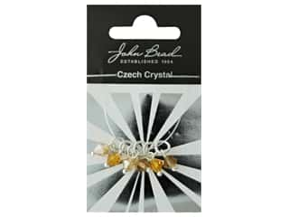 beading & jewelry making supplies: John Bead Czech Bicone Charms 6mm Amber Sunset